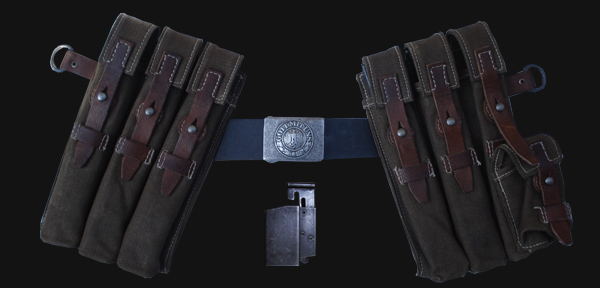 The MP40 Ammunition pouches as they would be worn by the user. Also pictured is the 'speed loader', which was pushed onto the top of the magazine to aid loading.