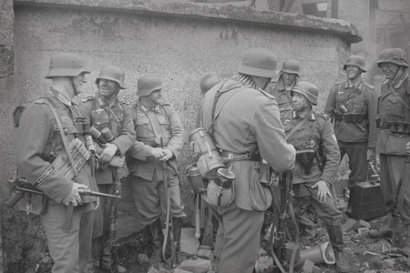 Grossduetschland troops share a joke after the battle.