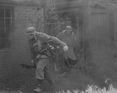 Grossdeutschland MG34 gunner and rifleman move out in a hurry