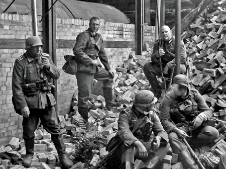 German soldiers smoke a pipe whilst resting