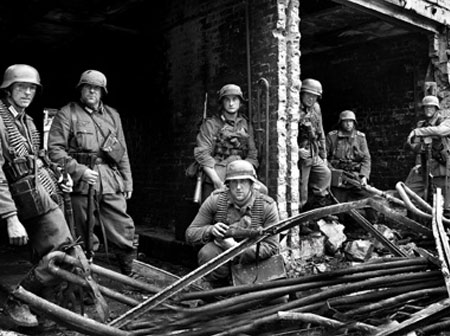 Grossdeutschland troops relax amid twisted metal