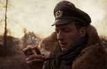 Wehrmacht officer lights his pipe